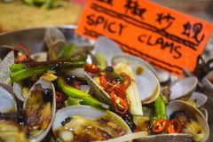 Spicy clams sold on a night market in Hong Kong stock photos
