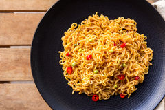 A plate of spicy indonesian fried noodle. Top view of spicy indonesian fried noodle with fork and napkin Royalty Free Stock Photos