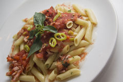 Plate of spicy tomato penne Stock Photo