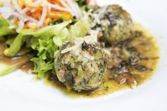 Plate with spinach dumplings and salad Royalty Free Stock Photo
