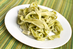 Plate of spinach fettuccine Royalty Free Stock Photos