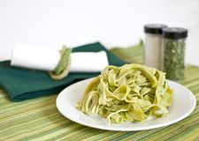 Plate of spinach fettuccine Stock Photography