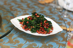 Plate of spinach salad with peanuts Royalty Free Stock Photos