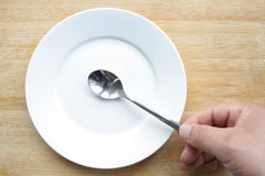 Plate and spoon. Close up plate and spoon Stock Image