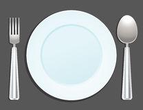 Plate, spoon and fork. On background Royalty Free Stock Image