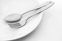 Plate with spoon and fork Royalty Free Stock Image
