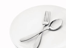 Plate with spoon and fork Stock Photos