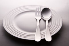 Plate With Spoon And Fork Stock Photography