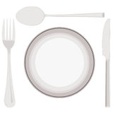 Plate, spoon, fork and knife Royalty Free Stock Images