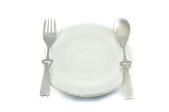 Plate with spoon and fork Stock Images