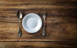 Plate and spoon with a fork Stock Image