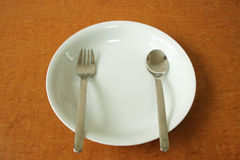 Plate with spoon and fork Royalty Free Stock Photography