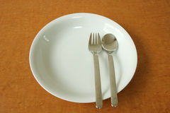Plate with spoon and fork Stock Photo