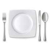 Plate with spoon, knife and fork Stock Photo
