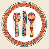 Plate, spoon, knife and fork with ethnic ornaments. Stock Photography