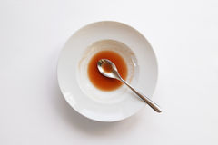 Plate with spoon and leftovers of soup Royalty Free Stock Photography