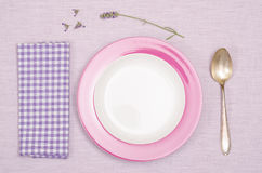 Plate, spoon, napkin with lavender flowers royalty free stock image