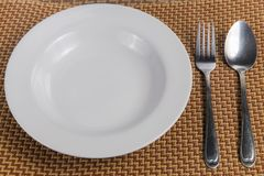 Plate with spoon, put together neatly Royalty Free Stock Images