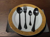 Plate and spoon Royalty Free Stock Photography