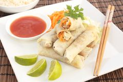 A plate of spring rolls with sweet and sour sauce Royalty Free Stock Images