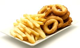 Plate of squid and chips. Surrounded by white background Royalty Free Stock Image