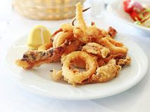 Plate with squid at a greek tavern. Mediterranean seafood royalty free stock image