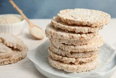 Plate with stack of crunchy rice cakes. On table stock image