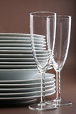 Plate stack and glasses Royalty Free Stock Images