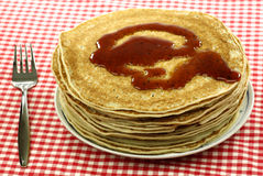 A plate with stacked freshly baked pancakes Stock Photos
