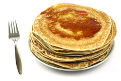 A plate with stacked freshly baked pancakes Royalty Free Stock Photos