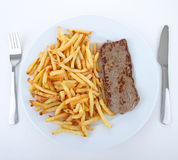 Plate of steak and french fries Stock Image