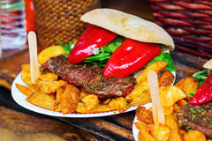 Plate with steak, fried potatoes and peppers Stock Image
