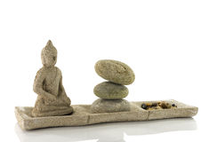 Plate with stones  and budha in balance Stock Photography