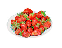 Plate of strawberries. Isolated against a white background Stock Photography