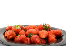 Plate with strawberries Stock Images