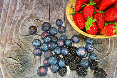 Plate with strawberries and bilberries royalty free stock photography