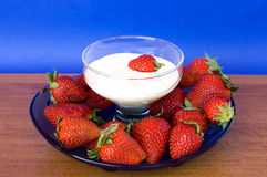Plate With Strawberries And Bowl With Yogurt On W Stock Images