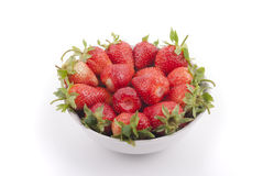Plate with strawberries. Isolated on white background Royalty Free Stock Images