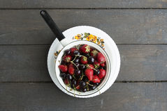 Plate with strawberries and sweet cherries Stock Image