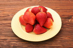 Plate of strawberries on a wooden background Royalty Free Stock Photo