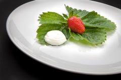 A plate with strawberry and cream Royalty Free Stock Photo