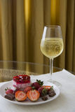 Plate of strawberry dessert and champagne Stock Photos