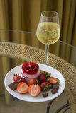 Plate of strawberry dessert and champagne Royalty Free Stock Photos