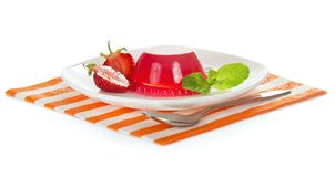 Plate with strawberry jelly on the striped napkin Stock Photography