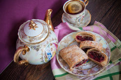 Plate of strudel. Sweet cherry strudel of puff pastry; two slices on plate stock photo