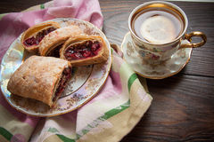 Plate of strudel. Sweet cherry strudel of puff pastry; two slices on plate royalty free stock images