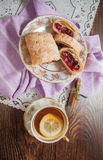 Plate of strudel. Sweet cherry strudel of puff pastry; two slices on plate royalty free stock photos