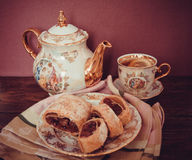 Plate of strudel. Sweet cherry strudel of puff pastry; two slices on plate stock photography