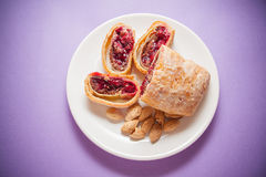 Plate of strudel. Sweet cherry strudel of puff pastry; two slices on plate stock photos