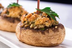 Plate with stuffed mushroom caps. Royalty Free Stock Photo